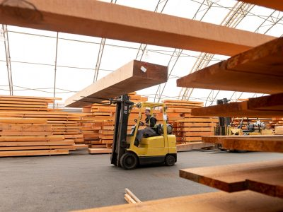 Wood mill and timber manufacturer. Male working in manufacturing. Industry and blue collar employment.